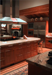 A large professional kitchen in Wyoming designed to be both residential in warmth, and functional as a hub for 3 to 4 kitchen staff frequently on hand.